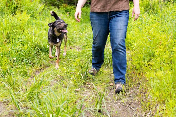 Asha and Marilyn walk along a trail together